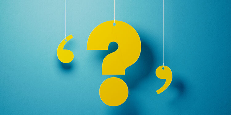 Yellow question mark with string hanging over blue background. Horizontal composition with copy space.